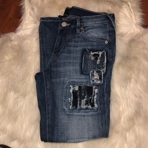 Cameron dark wash patch jeans with distressing